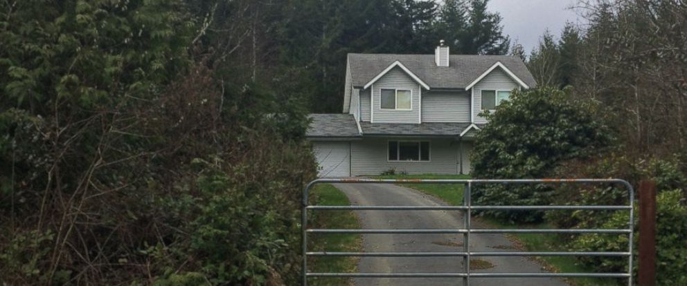 PHOTO: Emergency officials arrive at a home in Mason County, Washington, where a homeowner shot and killed an intruder.