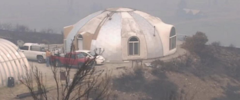 PHOTO: The cement monolithic dome, built by John Belles in 1999, survives fire on Aug. 22, 2015 in Omak, Wash.