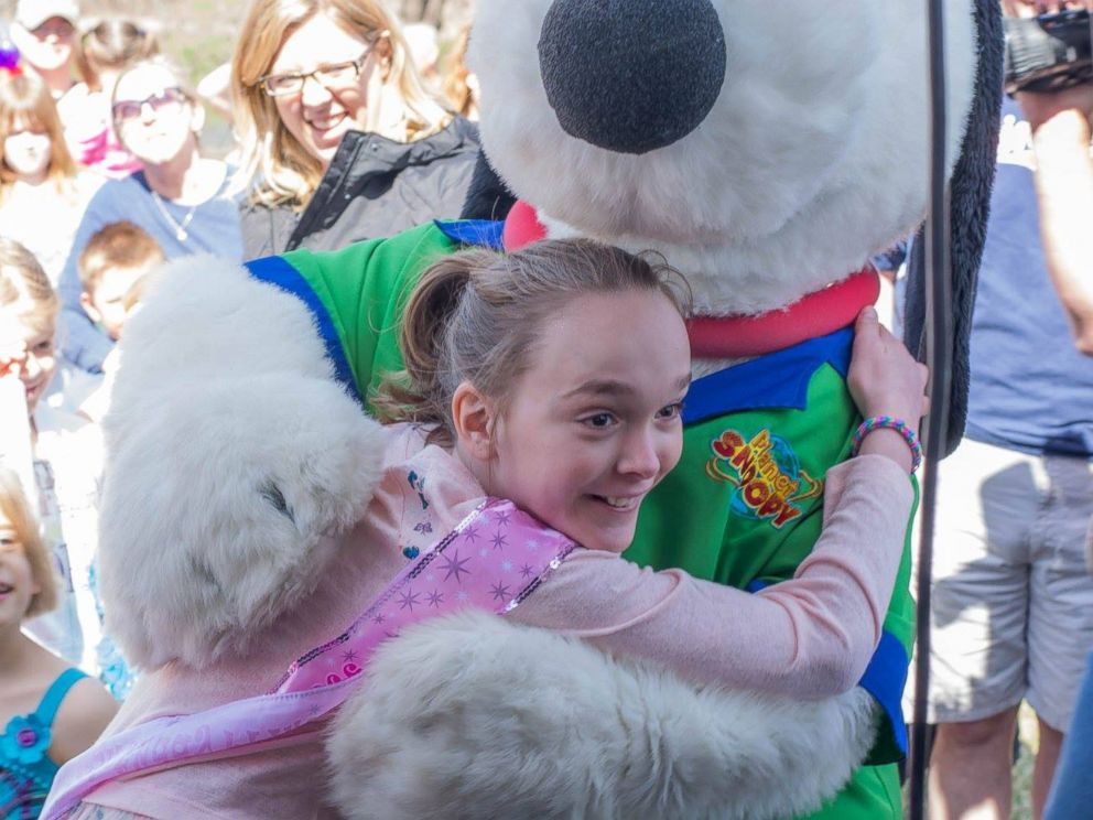 PHOTO: Mackenzie Moretter, turning 10 on April 21, 2015, is pictured here with a Snoopy mascot from Valleyfair Family Amusement Park at her birthday party in Shakopee, Minn., on April 18, 2015.