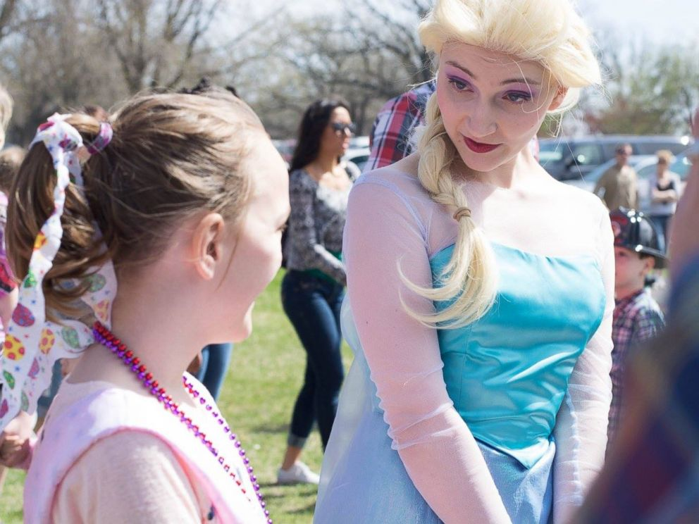PHOTO: Mackenzie Moretter, turning 10 on April 21, 2015, is pictured here with an Elsa from Frozen mascot from Valleyfair Family Amusement Park at her birthday party in Shakopee, Minn., on April 18, 2015.