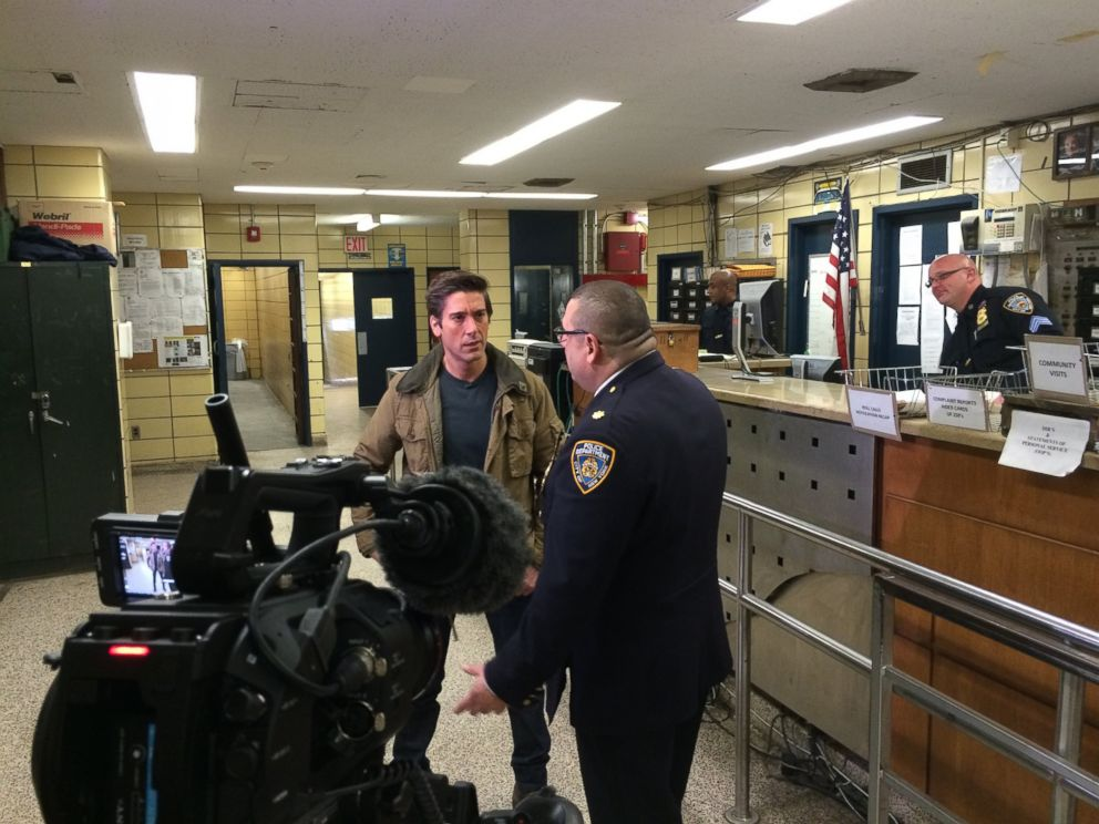 PHOTO: Muir with Deputy Insp. Joseph Gulotta, commander of the 67th Precinct in Brooklyn, in the stationhouse.