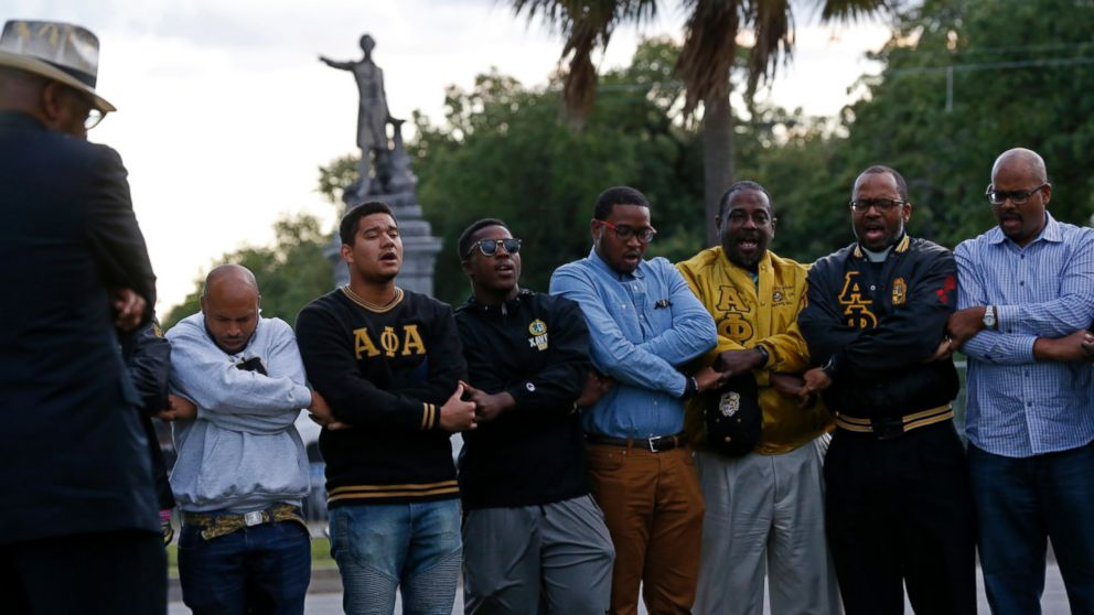 "Graduate members of Alpha Phi Alpha Fraternity pray during a ""social action prayer vigil"" across the street from the Jefferson Davis monument in New Orleans, Thursday, May 4, 2017. The group supports the removal of confederate monuments, and New Orleans Mayor Mitch Landrieu has removed one already and vowed to remove several more, one of which is the Jefferson Davis monument. (AP Photo/Gerald Herbert)"