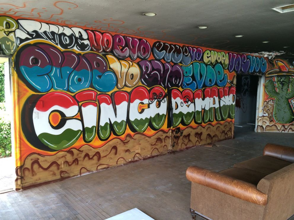 PHOTO: A graffiti-type wall painting is featured in the living room of Pablo Escobars former Miami Beach home.
