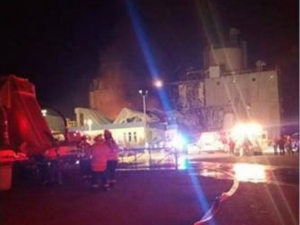 Emergency officials respond to an explosion at the Didion Milling plant in Cambria, Wisconsin.