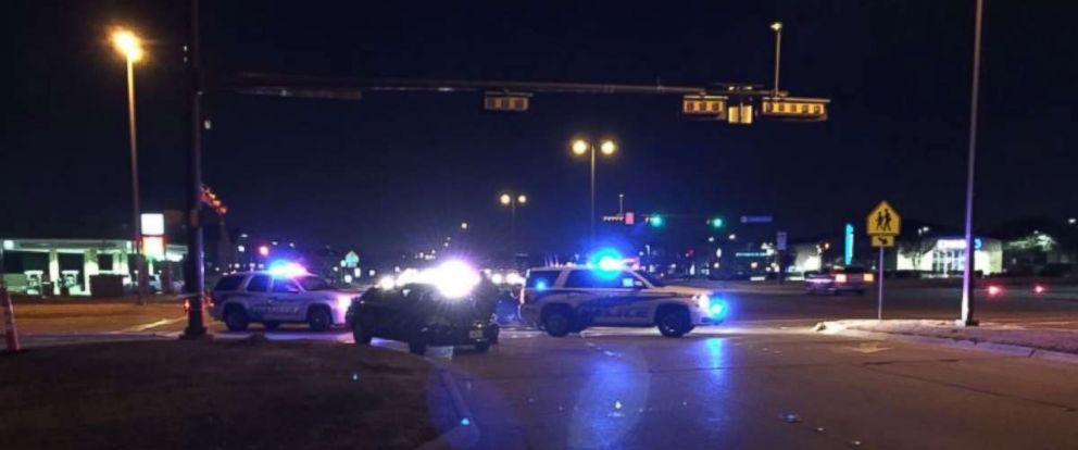 PHOTO: Police investigate a scene in Richardson, Texas where an officer was shot and killed on Wednesday.