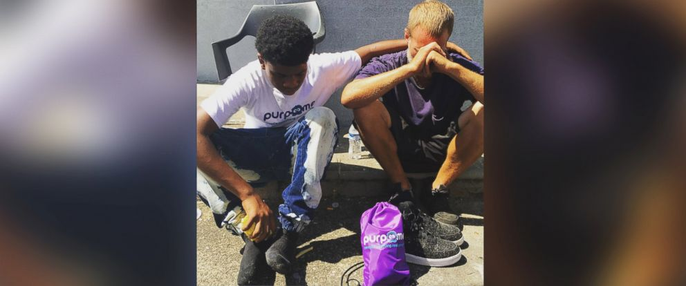 PHOTO: Laron Tunstill Jr, 14, gave away his shoes to a homeless man while doing community outreach with PurpMe in Louisville, Kentucky, on Monday, Sept. 5, 2016.