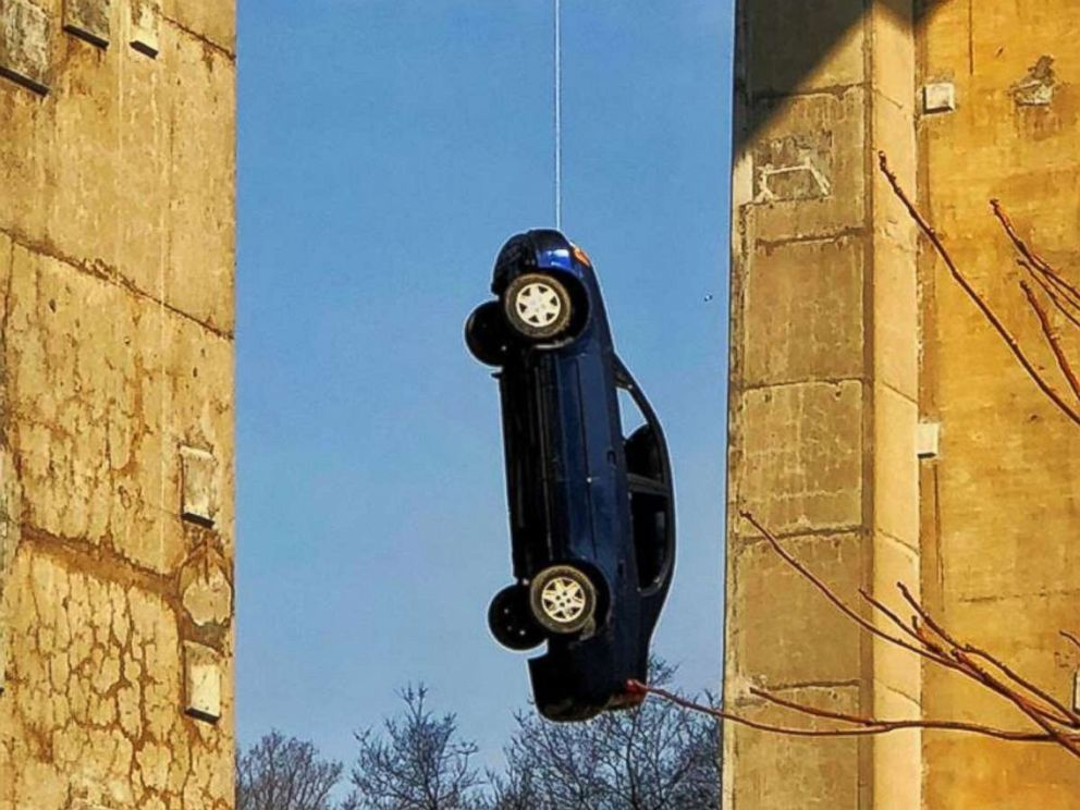 PHOTO: Police in Toronto investigate a mischievous prank that left a car dangling from a busy bridge.
