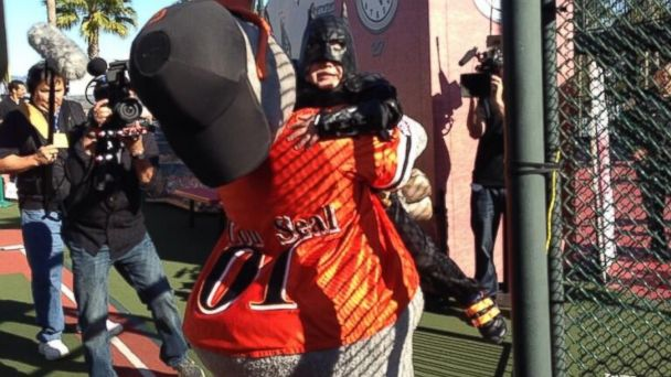 PHOTO: San Francisco Giants mascot Lou Seal embraces Miles Scott, better known as Batkid