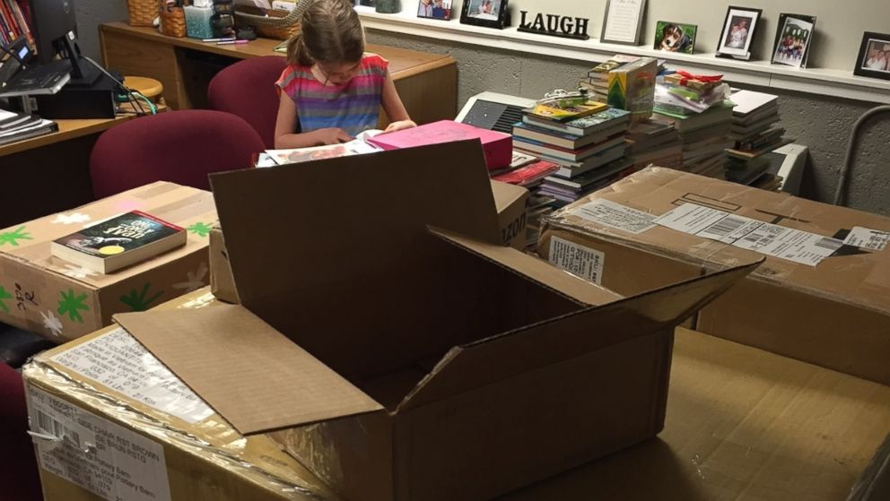 Heidi VanSumeren, 8, received hundreds of donated books after a fire at her Jackson, Michigan, home.