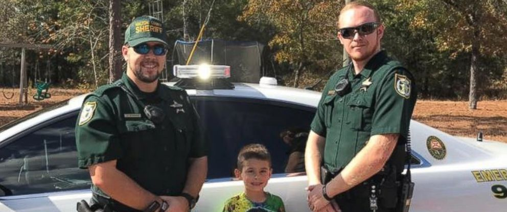 PHOTO: A Walton County, Florida, boy sits in a police cruiser after calling 911 to invite police officers to Thanksgiving Dinner.