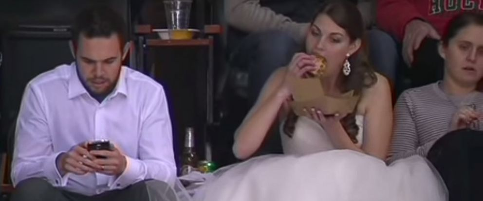 PHOTO: Newlywed Erika Skuta and Lewis Blake won hearts on the Internet after a video of Skuta eating a burger in her wedding dress at a Minnesota Wild hockey game posted on Nov. 29, 2015 went viral.