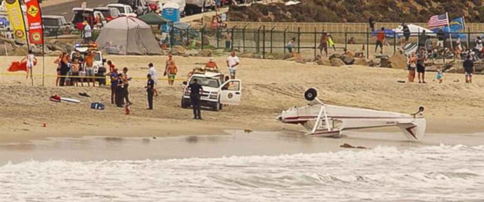 PHOTO: A small plane crash landed Saturday, July 4, 2015, on a beach in Carlsbad, California.
