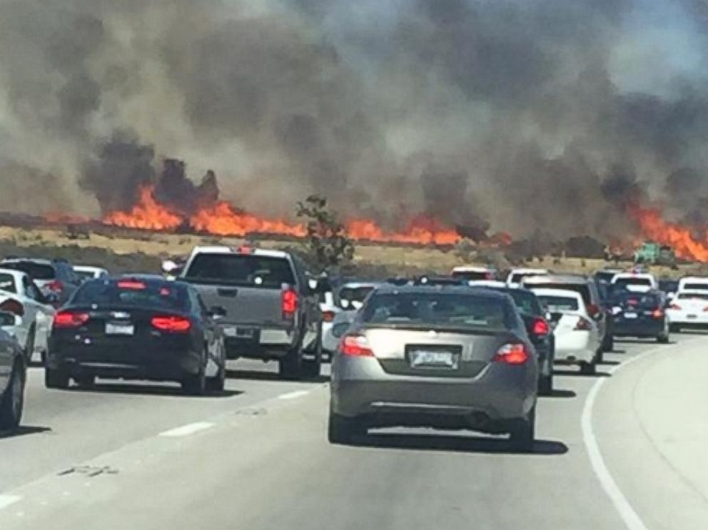 PHOTO: @Ausdboss posted this photo to Twitter on July 17, 2015 with the caption, On the freeway right next to the huge fire.