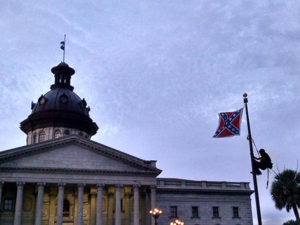 PHOTO: A woman climbed the flag pole in front of the South Carolina Statehouse and removed the Confederate flag.