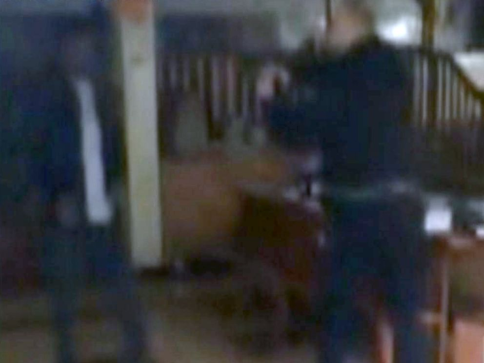 PHOTO: A video captured on a cell phone showed police confronting a man in a synagogue where a stabbing occurred.