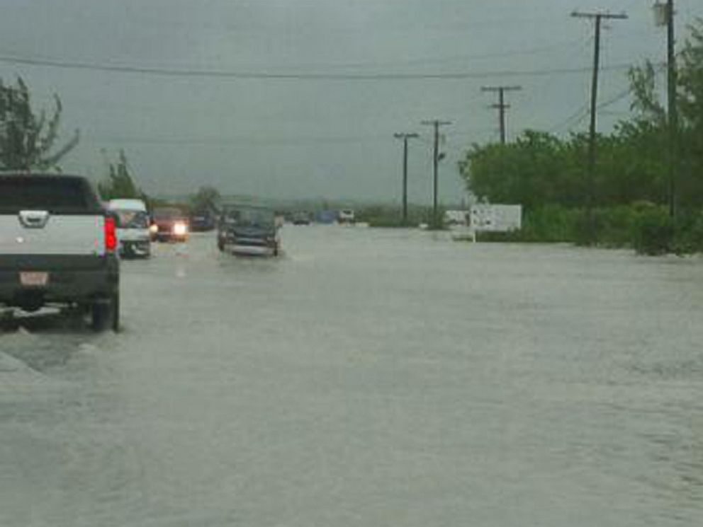 PHOTO: Heavy rain from Tropical Storm Cristobal brings flooding to The Turks and Caicos.