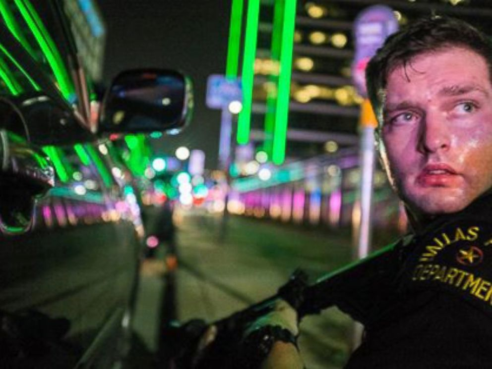 PHOTO: Freelance photographer Robert Moore took these photos while crouching down behind a Dallas police officer as gunshots rang out on July 7, 2016.