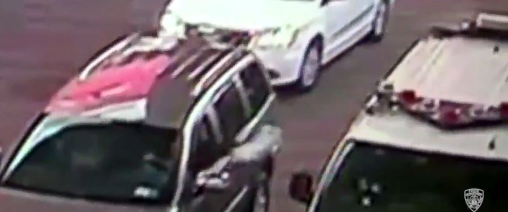 PHOTO: A driver is seen throwing an unknown device into a parked cop car in video released by the New York Police Department, July 21, 2016, to their Twitter feed.