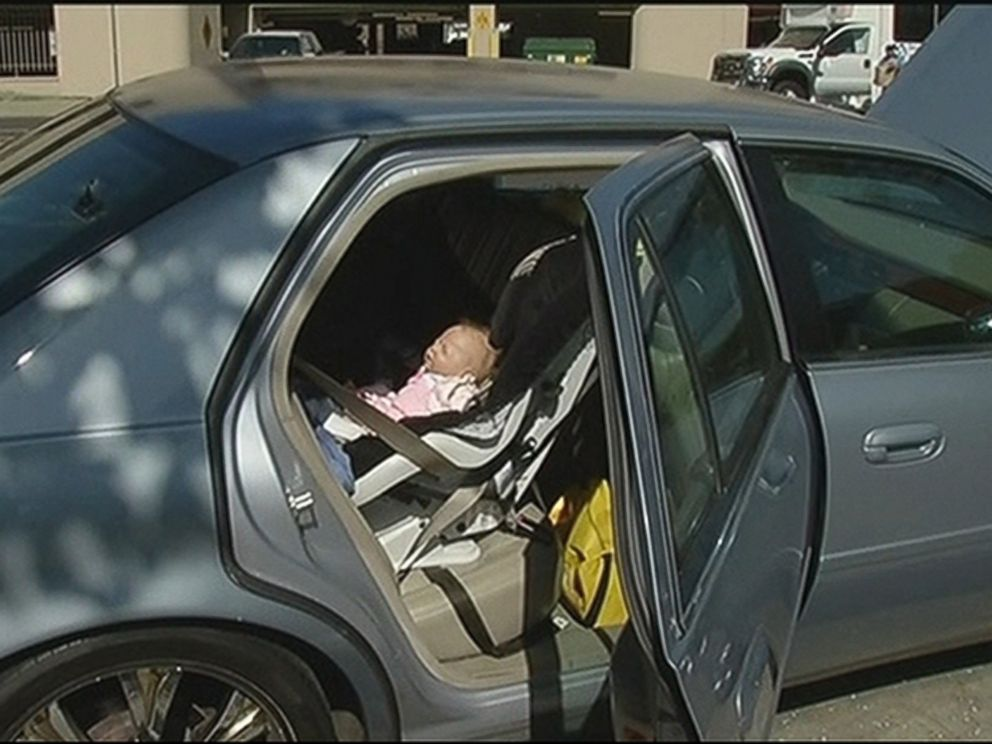 PHOTO: Police officers respond to a report of a baby trapped in a car and were surprised when it turned out to be a doll, Aug. 31, 2015, in Oakland, Calif.