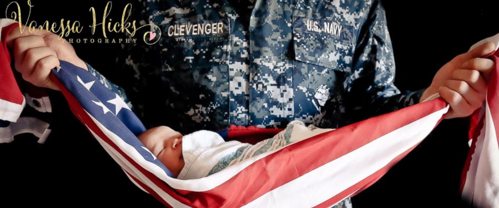 PHOTO: A picture of a baby being held by his father in an American flag sparked controversy online.