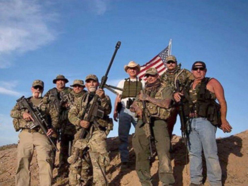 PHOTO: Gerald Delemus, center, is seen holding a .50 caliber machine gun in this undated photo.