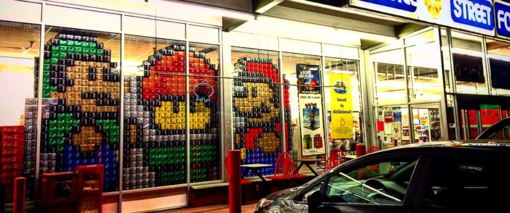"""PHOTO: A """"Super Mario Bros""""-themed window display made from 12-pack boxes of soda is pictured here at Orange Street Food Farm in Missoula, Montana."""
