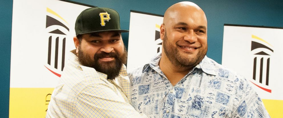 PHOTO: Brothers Christopher and Maake Kemoeatu, both former NFL players, celebrated their successful kidney transplant surgeries at a press conference Wednesday in Baltimore.