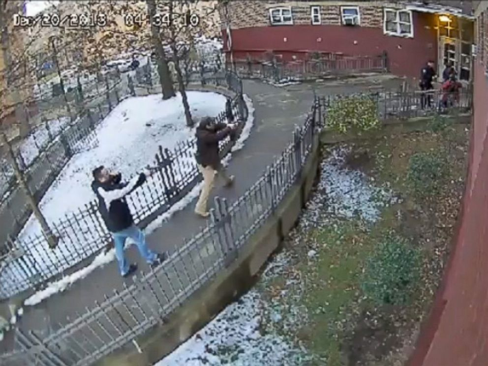 PHOTO: Surveillance video from December 2013 shows police officers in plain clothes approaching then 15-year-old Keston Charles with their guns drawn outside his Brooklyn apartment building.