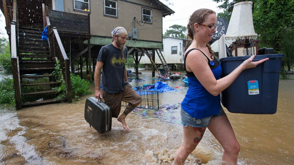 Getting out ahead of the flood, Michael Tramonte and Nikki Conger clear their possessions from their house on Watters Road, south of Hwy. 22 and east of Pontchatoula, Louisiana, ahead of the coming flooding Tangipahoa River as storms pound Tangipahoa Parish, Aug. 12, 2016.