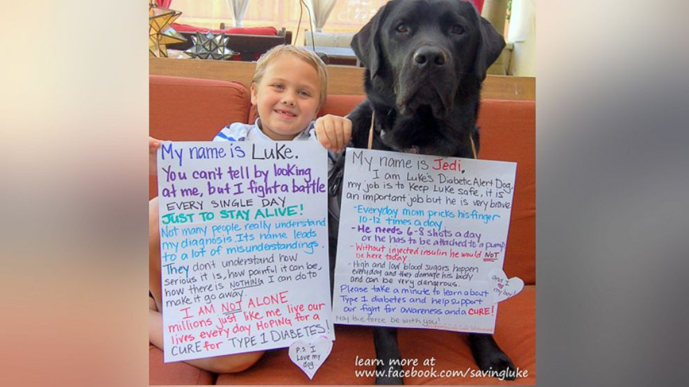 Luke Nuttall, a 7-year-old boy from Glendale, California, is pictured here with his diabetic alert dog named Jedi.