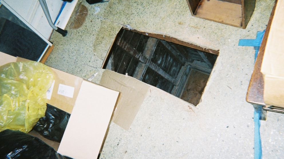 Hole cut through the floor of the Macys' tenant's apartment with a saw.