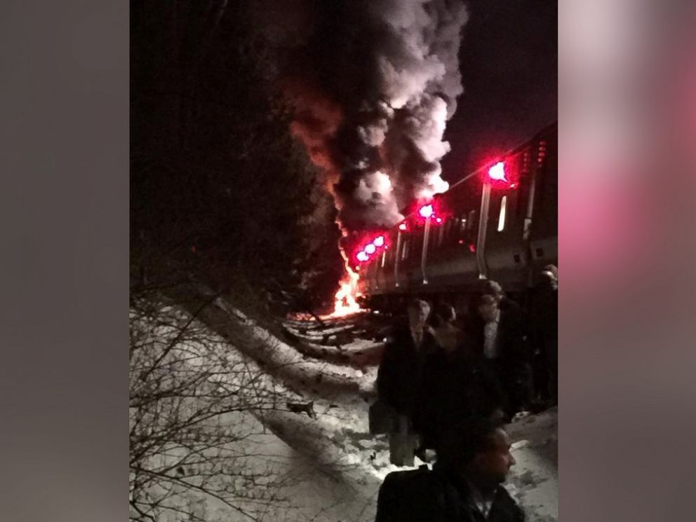PHOTO: Passengers being evacuated from a Metro North train after it struck a car, sparking a fire, north of White Plains, N.Y., Feb. 3, 2015.