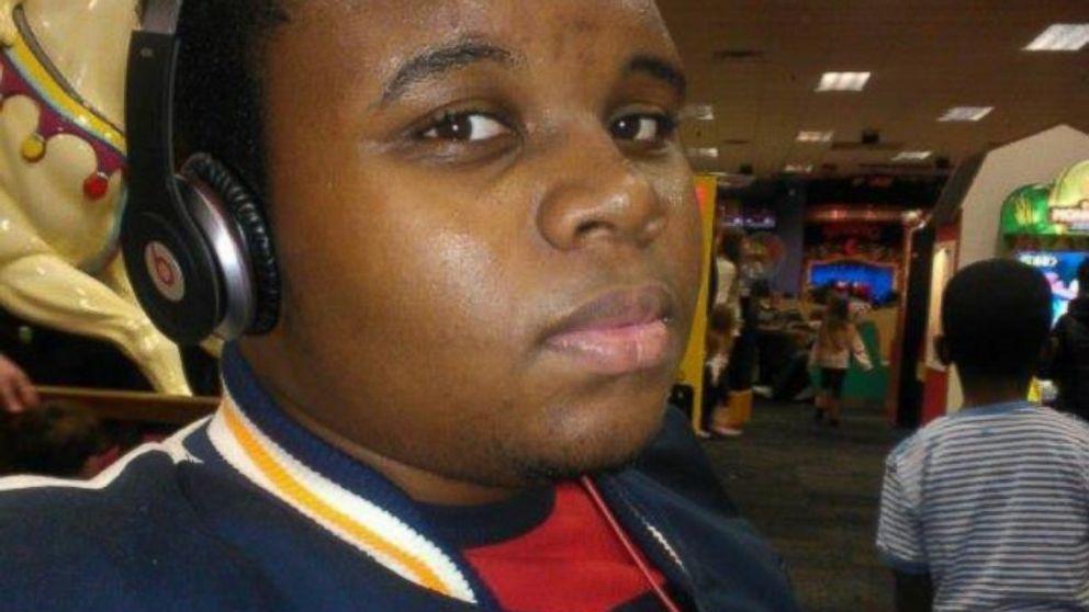 Surveillance video sheds light on Ferguson police shooting of ...