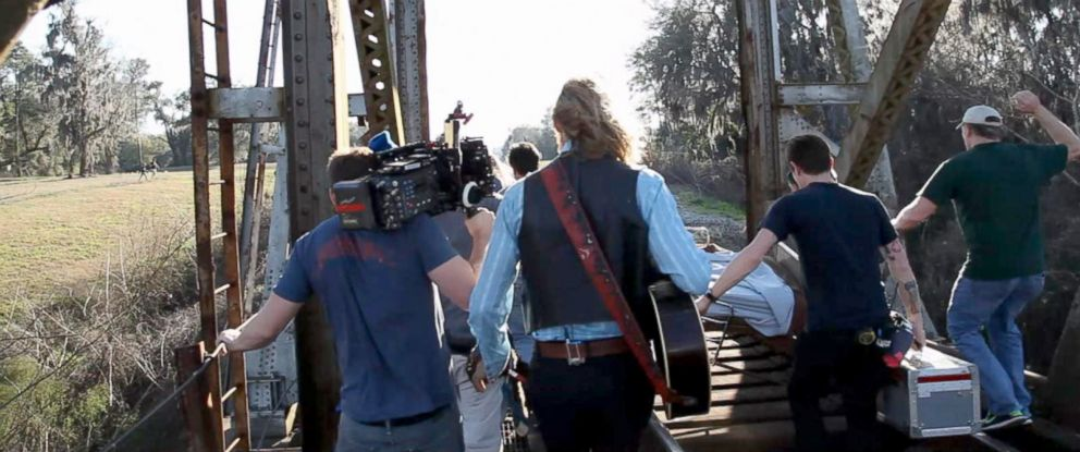 "PHOTO: New video obtained by ABC News shows the terrifying moments members of the ""Midnight Rider"" cast and crew scrambled to get off the train tracks as a freight train approached on Feb. 20, 2014."
