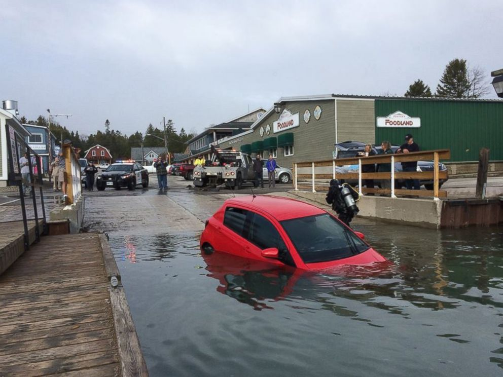 PHOTO: Diver Zsolt Vincze placed a hook on the submerged Toyota Prius to help retrieve it from the Georgian Bay in Tobermory, Ontario.