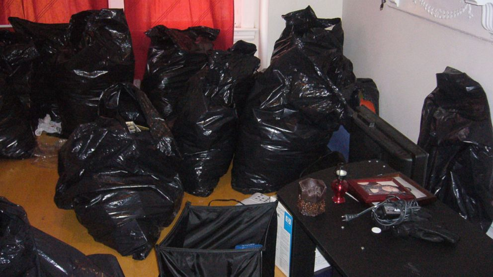 The belongings of several tenants were placed in these trash bags by their landlords, Kip and Nicole Macy, authorities said.