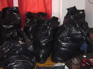 PHOTO: The belongings of several tenants were placed in these trash bags by their landlords, Kip and Nicole Macy, authorities said.