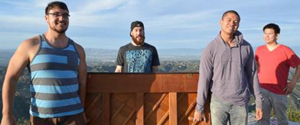 "PHOTO: Group claiming to be behind ""mystery piano"" poses in Santa Monica Mountains."