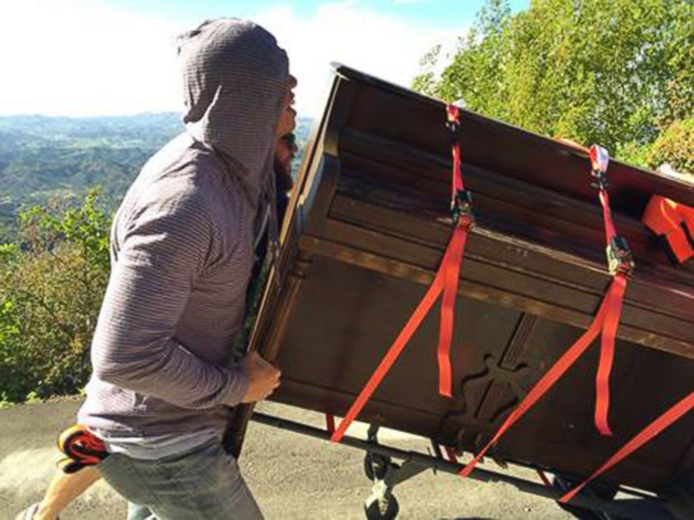 PHOTO: L.A. mystery piano being hauled up a hillside.