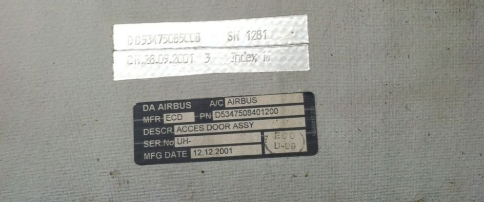 PHOTO: A plane door panel, seen here, landed on a golf corse in North Carolina.