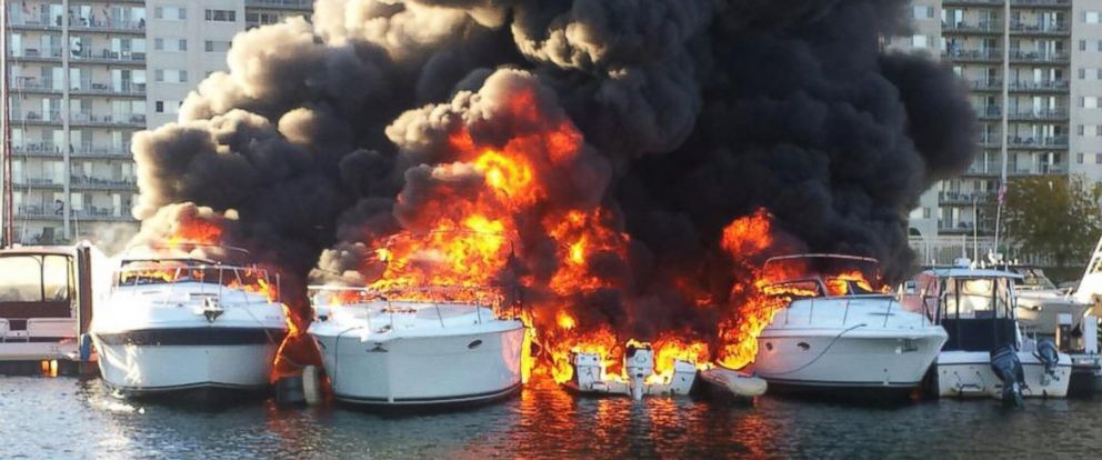 """PHOTO: Quincy Police posted this photo to Twitter on Oct. 8, 2015 with the caption,""""A picture taken earlier by Lt. Gillan of @quincymapolice Marine Unit of boat fire at Cove Way."""""""