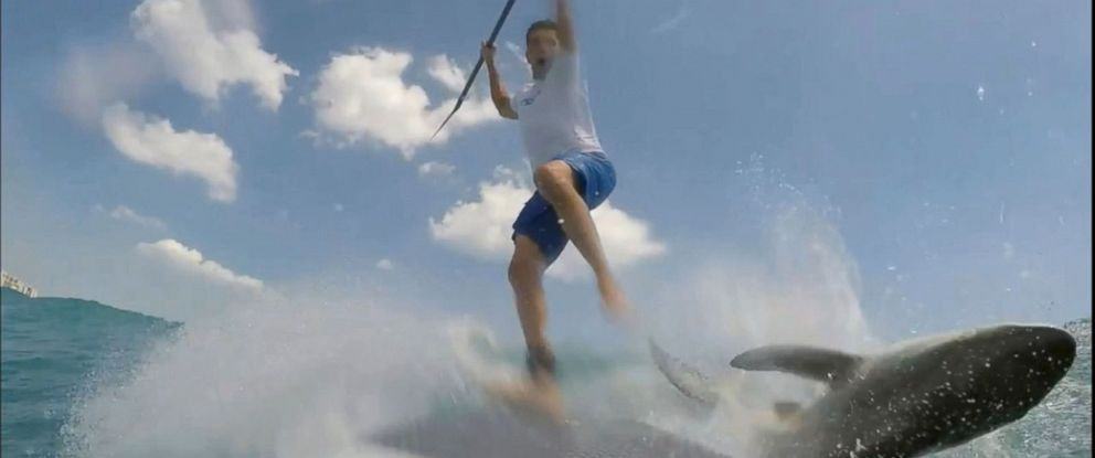 PHOTO: Maximo Trinidad reacting to a spinner shark that collided with his paddle board off the coast of Jupiter, Florida. Trinidad was knocked off his board.