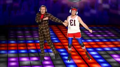 PHOTO: Stephen Colbert, right, and Bryan Cranston dance during Colberts video, StePhest Colbchella 013 - daft punkd, Aug 6, 2013.