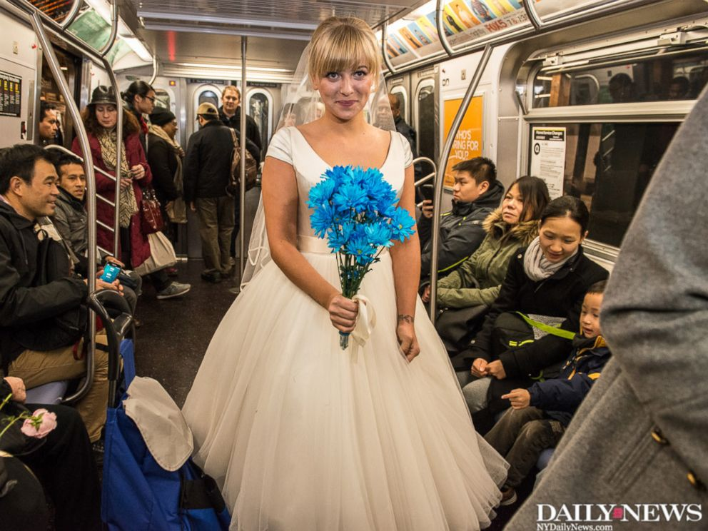 PHOTO: Hector Irakliotis and Tatyana Sandler celebrate their wedding on the N train