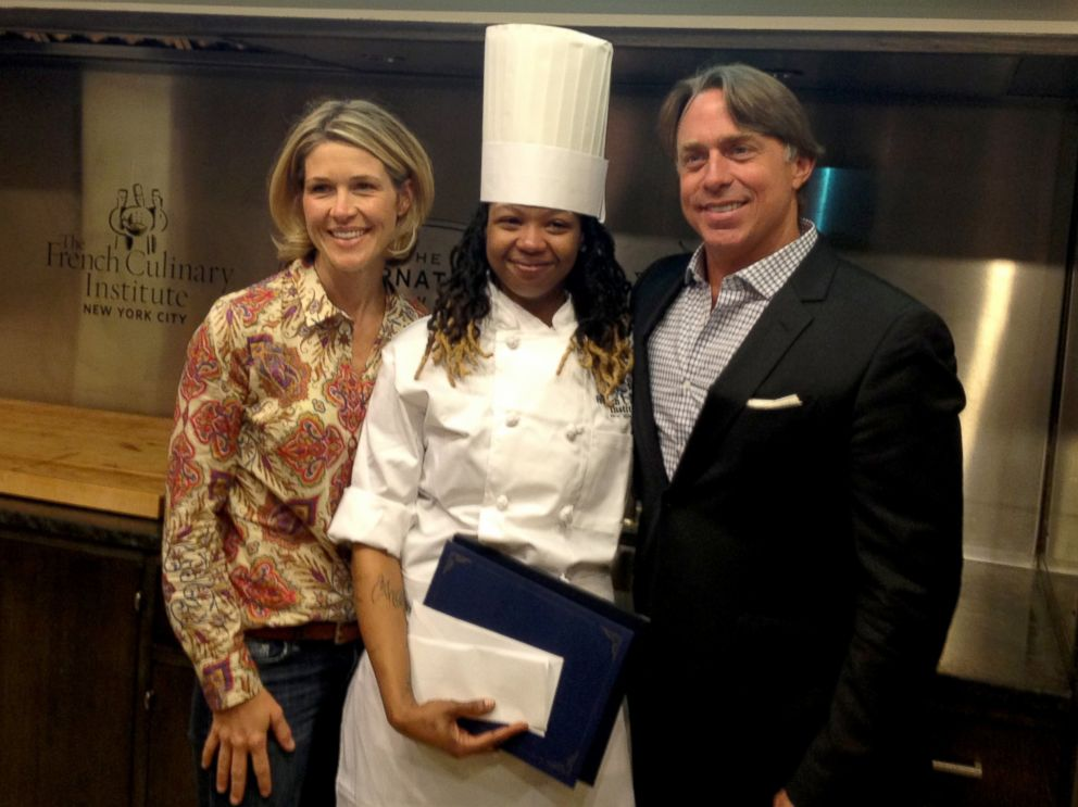 PHOTO: Jessica Bride, co-founder of the Chefs Move! scholarship poses with John Besh and Syrena Johnson.