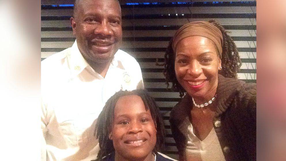 Tailor Cain, 12, center, with his parents, James and Tanya.