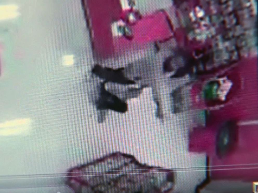 PHOTO: Surveillance footage from a Target in East Liberty, Pennsylvania shows a 2013 attack where Leon Walls grabbed a teenage girl from the checkout counter and threatened her with a knife.