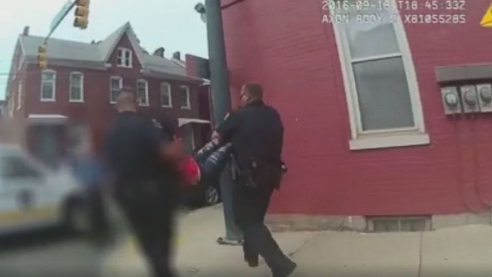 Hagerstown Police officers carry a 15-year-old girl who they described is uncooperative to a squad car Sept. 21, 2016.