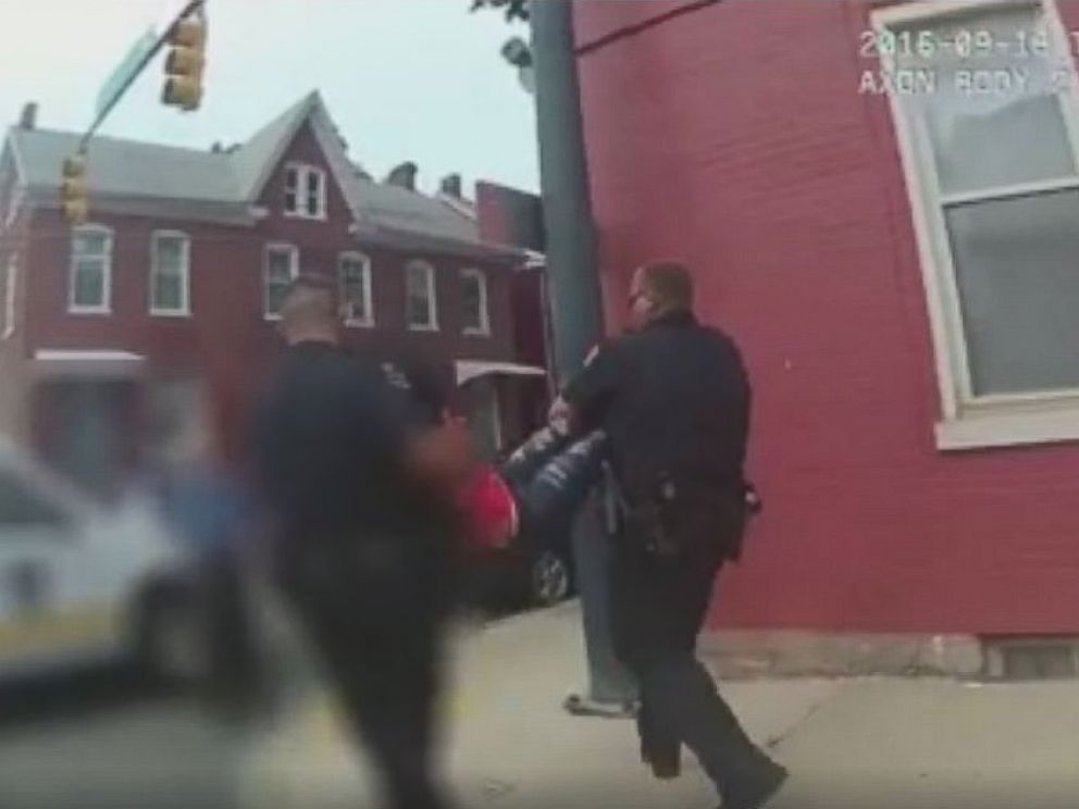 PHOTO: Hagerstown Police officers carry a 15-year-old girl who they described is uncooperative to a squad car Wednesday afternoon.