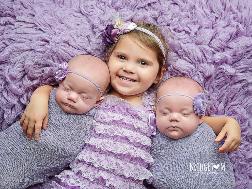 PHOTO: Kenedi and Kendal Breyfogle, 4 months, with their big sister Teagan, 2.